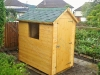 Apex Shed with shingles on roof